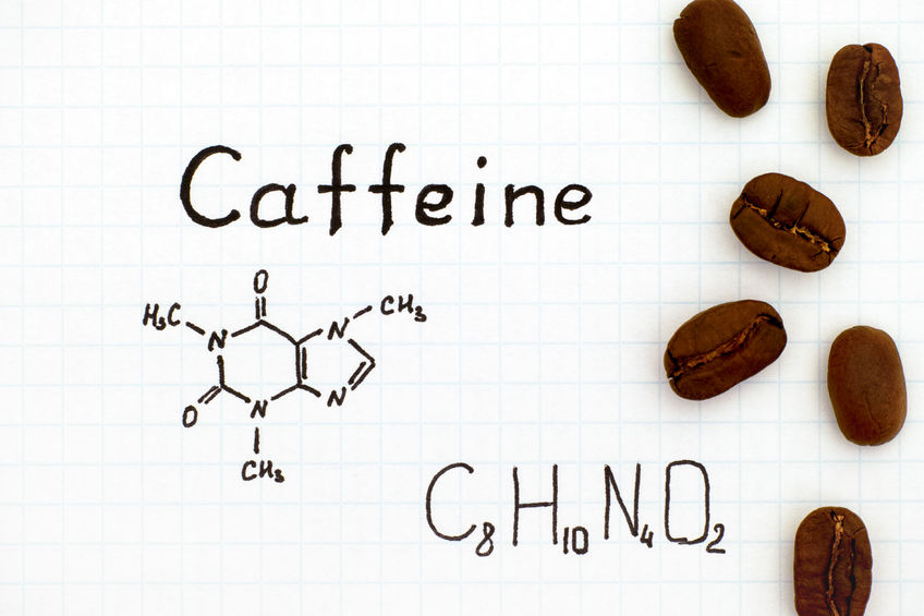 84914648 - chemical formula of caffeine with coffee beans. close-up.